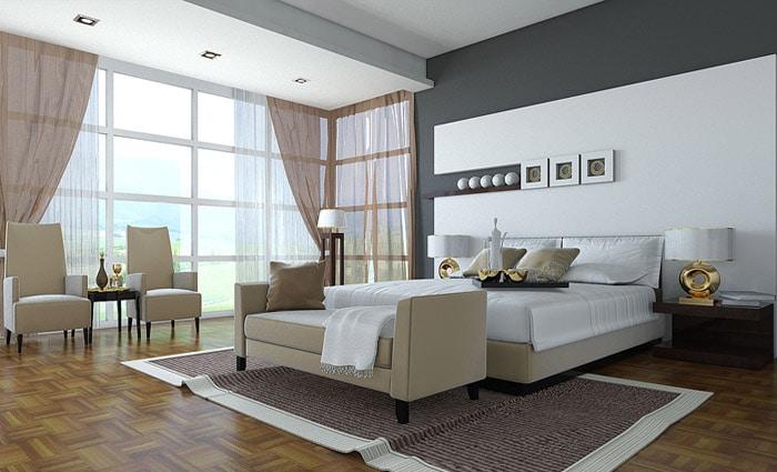 grote moderne slaapkamer met zetel en meubels