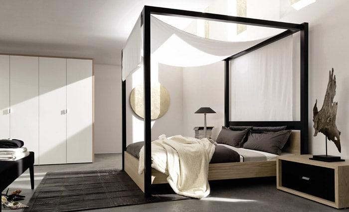 slaapkamer met modern hemelbed in zwart
